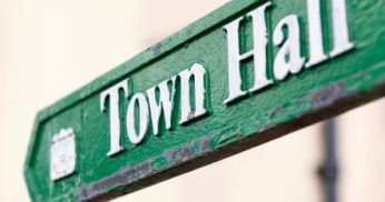 grassroots community organizing town hall sign gets your vote approved